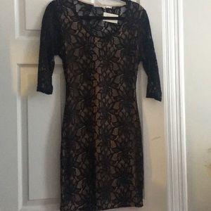 Bodycon 3/4 sleeve dress with cutout back